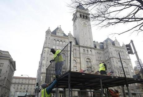 Workers built staging in front of the Trump International Hotel as preparations for the Donald Trump's inauguration took place.